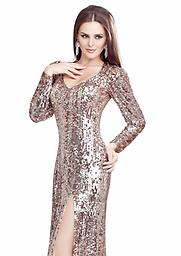 Champagne Primavera 9701 This classically styled, sparkle-studded gown by Primavera Couture 9701PC exudes sophistication. The deep V-neckline delineates your lovely contours and the slender long sleeves sparkle from shoulder.