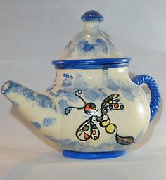 B- Blue & White Teapot w/ Dragonfly This is hand painted teapot that holds 16 oz. so it just takes one tea bag to make a pot of brewed tea.