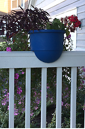 "12"" Round Railing Deck Planter Add color to your front porch or deck with this durable railing planter."