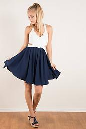 Navy and White Criss Cross Back Cutout Side 20sd3009 This scalloped white and navy, criss cross dress with side cutouts is sure to make a statement!