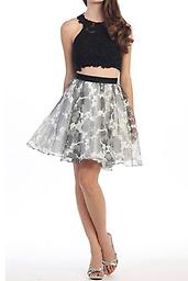 Black and White Floral Two Piece 4642-01 This super cute halter two piece will have you twirling the night away with its flirty chiffon skirt and embellished top with subltle yet elegant sparkle.