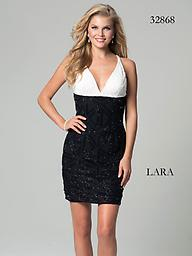 Lara 32868 White/Black Sparkling Contrast Sizzle in this Lara 32868 cocktail dress. This dress has a halter-style neckline with tonal beading at the bust. The empire waist breaks into contrast color with tonal detail throughout.