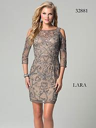 Lara 32881 Lead Cold Shoulder Look brilliant when you walk into the party wearing this cocktail dress from Lara 32881. This dress has cold shoulder detail and quarter length sleeves. Sparkling stones wind throughout the dress.