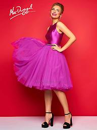 Mac Duggal 30320 Magenta High Neck Tea Length Mac Duggal style 30320C is a fall must-have! The boat neck silk top is complemented with a beaded belt & knee length tulle skirt. Take it from day to night by dressing up or down with flats or pumps.