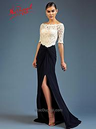 Mac Duggal 80505 Black/White T-Shirt Gown This off the shoulder boat neck dress is a casual take on a formal dress. The top of the dress is white sheer lace half sleeve that is brought together by a black jersey skirt.