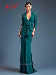 Mac Duggal 80518 Teal Long Sleeve Gown Subtly introduce color into your fall/winter wardrobe with this teal sheath dress. With a plunging v-neckline and sheer lace three quarter length sleeves this dress combines class and style.