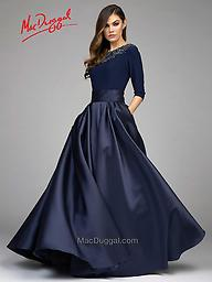 Mac Duggal 80682 Midnight Blue 3/4 Length Sleeve Gown This Mac Duggal couture ball gown will be the perfect dress for any occasion. Three-quarter length sleeves and boat neck will keep you warm, with an embellished collar adding weight and glamour.