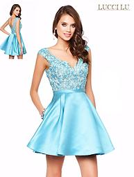 Lucci Lu 8120 Light Blue Cap Sleeve This Lucci Lu design features a v-neckline as well as a v-back, and a lacey top with a nude underlay. This dress puts a fun twist on elegance with its satin skirt that has pockets!