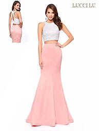 Lucci Lu 8106 Blush Two Peice Gown You will love this fun and flirty Lucci Lu two piece gown. It features a white beaded sparkle top and a fitted mermaid style blush pink skirt.
