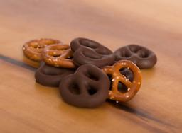 Milk Chocolate Covered Pretzels A double twist of fate in this great combination. The ultimate taste of milk chocolate smothering crispy, salted pretzels.