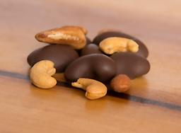 Dark Chocolate Covered Assorted Nuts A delicious mixture of roasted and hand selected, whole pecans, brazils, almonds and cashews drenched in dark chocolate.