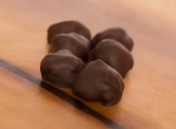 Dark Chocolate Covered Coconut Moist, chewy coconut encompassed in rich dark chocolate. Sure to please any coconut lover.