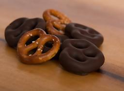 Dark Chocolate Covered Pretzels A double twist of fate in this great combination. The ultimate taste of dark chocolate smothering crispy, salted pretzels.