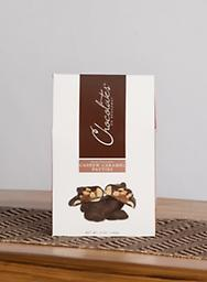 Dark Chocolate Covered Cashew Caramel Patties-Grab & Go A luscious blend of soft, chewy caramel atop a mound of fresh roasted cashews drenched in dark chocolate.