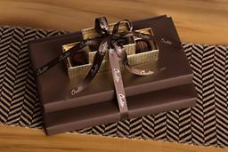 Chocolate Indulgence Gift Tower Our Chocolate Delight Gift Tower is wrapped in elegant brown textured gift wrap and finished with our classic brown ribbon.