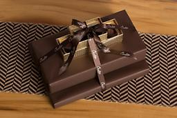 Chocolate Deluxe Gift Tower Our Chocolate Delight Gift Tower is wrapped in elegant brown textured gift wrap and finished with our classic brown ribbon.