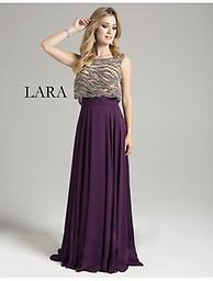 Lara 32928 Plum Sleeveless Loose Top Empire Waist This sleeveless dress has fine beaded detail throughout the bodice. This gown has an empire waist with a contrast flowing skirt. This gown is full length, making it perfect for any formal party.