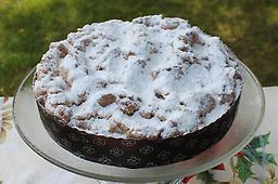Hahn's Famous Classic Crumb Cake German style crumb cake. Large, handmade butter-cinnamon crumbs top an ultra moist vanilla cake. Finished with a dusting of confectionary sugar on top.
