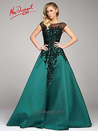 Mac Duggal 48511 Emerald or Cream Cap Sleeve Gown A dress made for royalty, this cap sleeve Mac Duggal dress is lavishly wonderful. A sweetheart neckline lays under a sheer black boat neck and embroidered lace appliqué, the beauty is in the details.