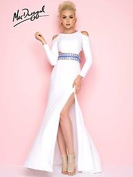Mac Duggal 77238 White or Red Cold-Shoulder Gown Capture everyone's attention in this Mac Duggal gown that shows off cold shoulder, long sleeves, Jersey fabric with a high leg slit.
