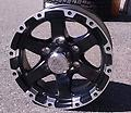 Black Trailer Wheels Caps Lugs 15x6 6on5.5 - Set of 4 new wheels, caps and 24 lug nuts. Wheels are 15x6 and 6x5.5 bolt pattern. Matte black with machined accents.