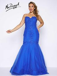 MacDuggal 77175 Bustier Gown, Electric Blue, Black Strapless, sweetheart neckline, taffeta mermaid dress with mesh and beaded lace applique, open back and small train. Available in sizes 14W-26W in Electric Blue and Black.