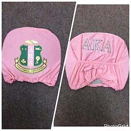 AKA Headrest Cover AKA pink and green headrest cover with shield and letters
