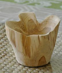 Teak Bowl (Round) This very unique handcrafted Teak Bowl could be used solely for decoration, filled with fruit, or lined and filled with flowers. Each bowl varies slightly.