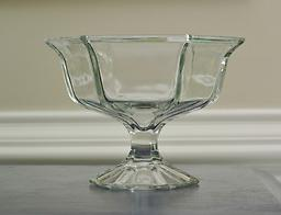 Glass Compote A versatile addition to any kitchen or arranging arsenal. Serve a dip in it or arrange a titillating pavé-style floral arrangement in this lovely glass compote. Would be wonderful used in repetition!