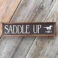 """Country Signs, Barn Signs, Farm and Ranch, Horse Decor, Saddle Up, Outdoor and Indoor Signs - Measurements are approx. 6"""" x 26"""". Distressed brown background with linen font and horse stencil. Farm and Ranch, Country Signs, Barn Signs, Horse Decor"""