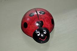 Ladybug Bank Money bank in the shape of a Ladybug, made from a gourd. Cute and functional.