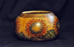 Sunflower Bowl Gourd bowl with a sunflower design on it.
