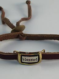 """""""Blessed Adjustable brown leather bracelet has an alpaca silver plate with a message."""