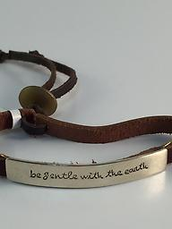"""""""Be Gentle With The Earth"""" Adjustable brown leather bracelet with alpaca silver plate with a message."""