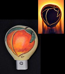 Peach Night Light This night light has a fresh, ripe peach on the design, painted in realistic colors and carved to let just the right amount of light into the dark color of your room.