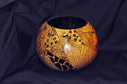 Crazy Quilt Bowl A gourd bowl divided into section, each section having a wood-burned pattern in it.