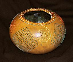 Embroidered Bowl A gourd made into a bowl with a hand-embroidered design on it.