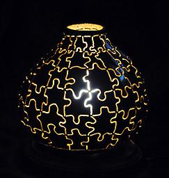 Jigsaw Lantern Imagine the pieces of a puzzle fitted together so that light shines between the pieces!