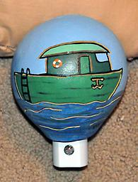Boat Night Light A cute night light design for a nautical nursery! This night light shield was made from a small gourd, painted and carved to show a boat floating in the water.