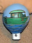 Boat Night Light - A cute night light design for a nautical nursery! This night light shield was made from a small gourd, painted and carved to show a boat floating in the water.