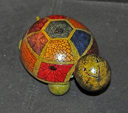 Turtle (Medium) Cute turtle figurine with a variety of markings on its sections. Choose from multi-colored or normal green. See other store listings for other sizes and options.
