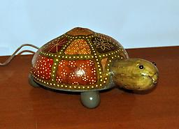 Turtle (Large) Cute turtle figurine with a variety of markings on its sections. Choose from multi-colored or normal green. See other store listings for other sizes and options.