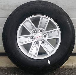 """17"""" GMC Sierra Yukon Savana Wheels Tires 1500 1988-2018 This is a set of new take off wheels & tires with less then 25 miles on them. Factory alloy 17"""" rims with General Grabber HT tires."""