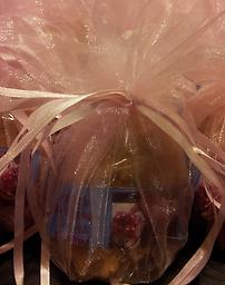 Zoe Girl Baby Shower Favors (50ct)/With Organza Drawstring Bags Delight your guests with these adorable, rich and creamy praline favors that are chock-full of pecans. They can be purchased with or without organza drawstring bags. A favor tied in perfect delight