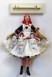 """Annie Ragbaggedy A wall hanging of Annie Ragbaggedy who carries the """"Raggedy Ann"""" characters in her apron"""