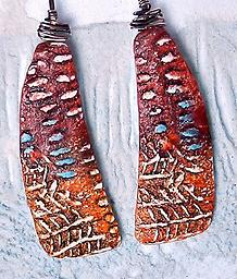 Homage to Tucson Earrings Iconic turquoise and rust colors of the Southwest paint these one-of-a-kind stunners, patterned with primitive motifs.