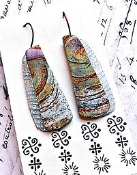 Sea Cave Earrings Swirling matte veneers in tide pool colors are outlined with iridescent, textured slices.