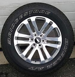"""18"""" OE Chevy Colorado Wheels & Tires This is a factory set of Colorado / Canyon wheels. Polished 18"""" wheels with New / Stickered Bridgestone Revo AT 265/60R18 tires."""