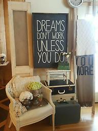 Dreams Don't Work unless you do This sign is perfect for any home office. Black BKG white lettering and walnut frame 24x36