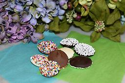 Non-Pareils Quarter size droplets of creamy milk,dark or white chocolate sprinkled with colored candy seeds. A sure delight for all ages.